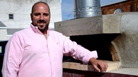Molto Vino wine bar owner Massimiliano Garguilo, 38,