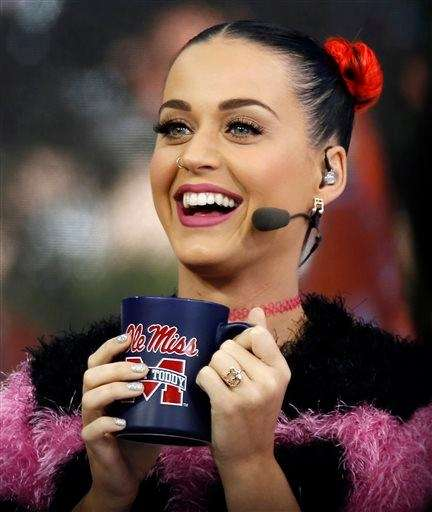 Singer Katy Perry cheers for Mississippi during a
