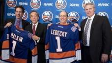 From left, new Islanders owner Scott Malkin, Islanders