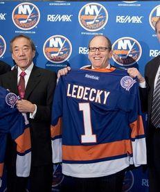 From left, new Islanders owner Scott Malkin, Islanders