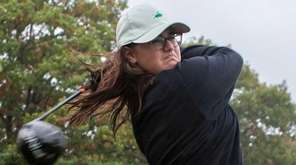 Jennifer Rosenberg, 15, practices her swing at Glen