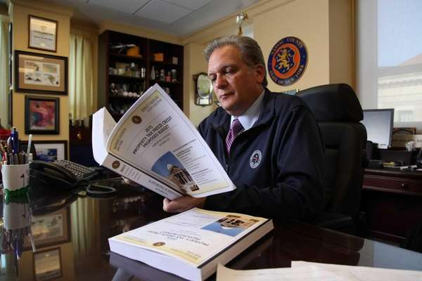 Nassau County Executive Edward Mangano works on the
