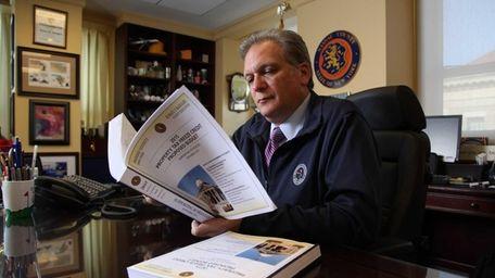 Nassau County Executive Edward Mangano works on the
