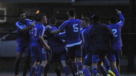 Hauppauge players celebrate their double-overtime win with seconds