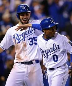 Eric Hosmer celebrates with Terrance Gore of the