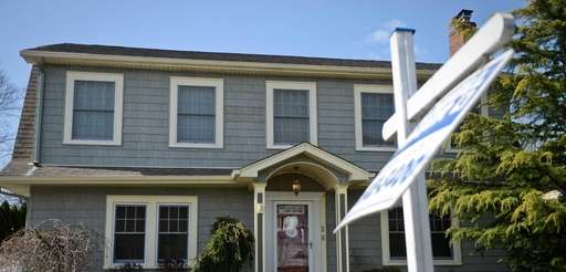 This three-bedroom home in Amityville is shown in