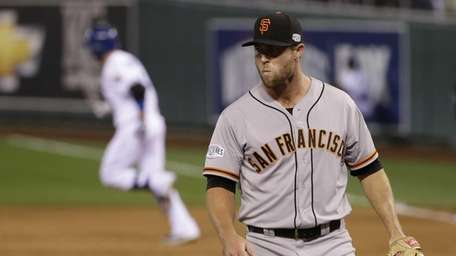 San Francisco Giants pitcher Hunter Strickland watches as