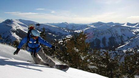A snowboarder heads down a run at Jackson