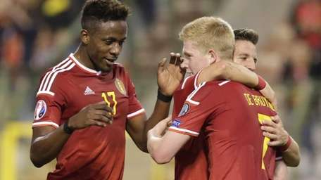 Belgium's Kevin De Bruyne, right, gets congratulations from