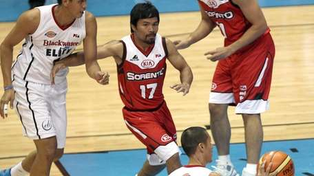Manny Pacquiao, center, the playing-coach of KIA Sorentos