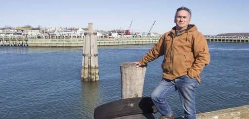 Commercial fisherman Sid Smith, from Greenport, stands on