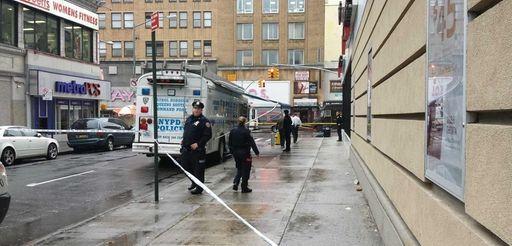 New York Police Officers investigate the scene of