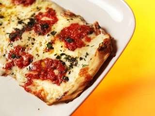 A three-cheese grilled Margherita pizza is one of
