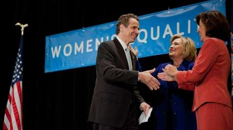 Hillary Rodham Clinton appears with Governor Andrew M.