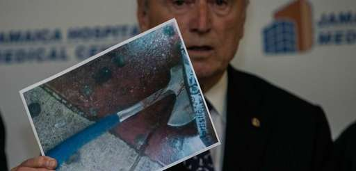 Police Commissioner William J. Bratton holds a photo