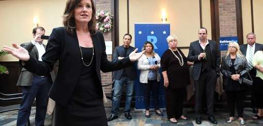 Nassau County District Attorney Kathleen Rice talks with