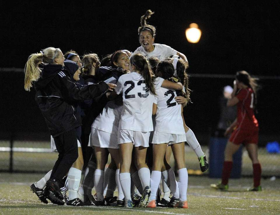 Northport players celebrate their 1-0 overtime win against