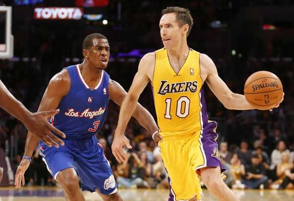 Los Angeles Lakers' Steve Nash, right, passes off
