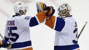 Islanders defenseman Johnny Boychuk congratulates goalie Chad Johnson