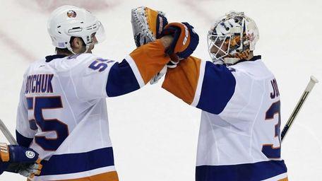 Islanders defenseman Johnny Boychuk congratulates goalie Chad Johnson
