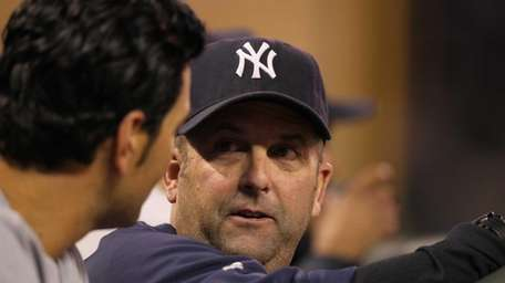 Kevin Long of the Yankees talks in the