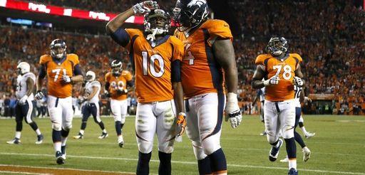 Denver Broncos wide receiver Emmanuel Sanders salutes after