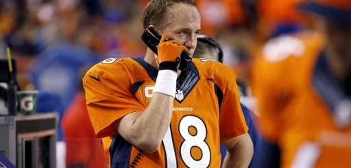 Denver Broncos quarterback Peyton Manning talks to the