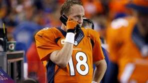 Denver Broncos quarterback Peyton Manning talks to the