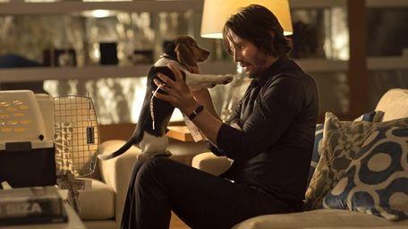 Keanu Reeves as John Wick in a scene
