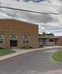 An exterior image shows John Pearl Elementary School