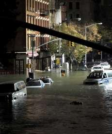 Submerged cars on Ave. C and 7th St