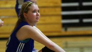 Lauren Hill takes a break as she practices