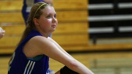 Lauren Hill takes a break as she practices