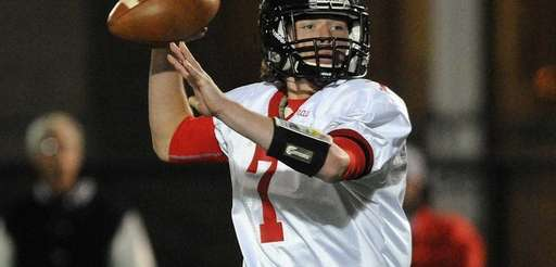 Syosset quarterback William Hogan throws a pass during