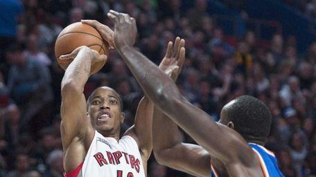 Toronto Raptors' DeMar DeRozan shoots as Knicks' Samuel
