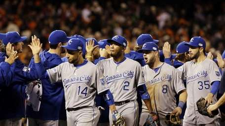 The Kansas City Royals celebrate after Game 3