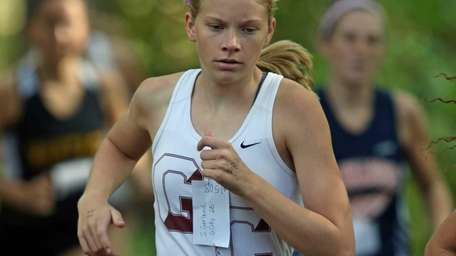 Stephanie Gerland of Garden City enters the woods