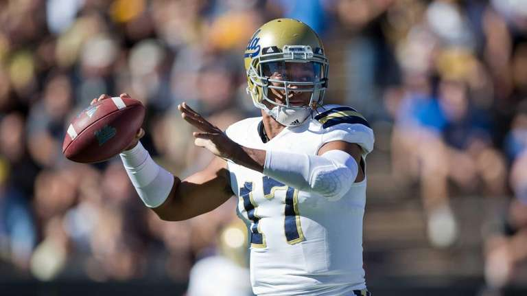 UCLA quarterback Brett Hundley throws a pass during