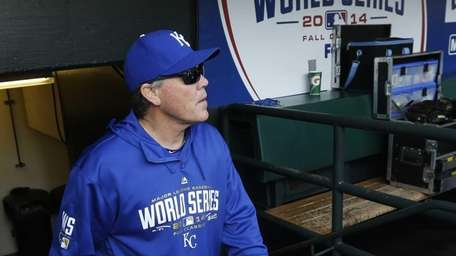 Kansas City Royals manager Ned Yost walks into