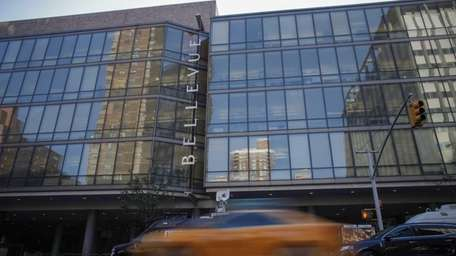A taxi passes in front of Bellevue Hospital