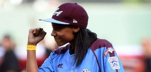 Little League pitcher Mo'ne Davis reacts after throwing
