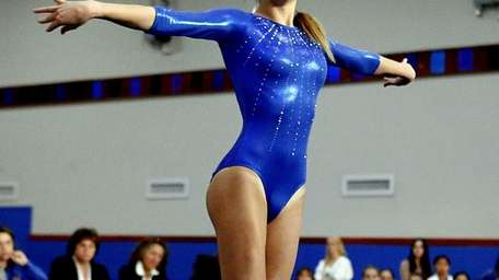 Kellenberg's Vittoria Notaro performs her floor exercise on