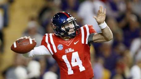 Mississippi quarterback Bo Wallace passes during the first