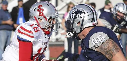 Stony Brook quarterback Conor Bednarski (16) goes toe