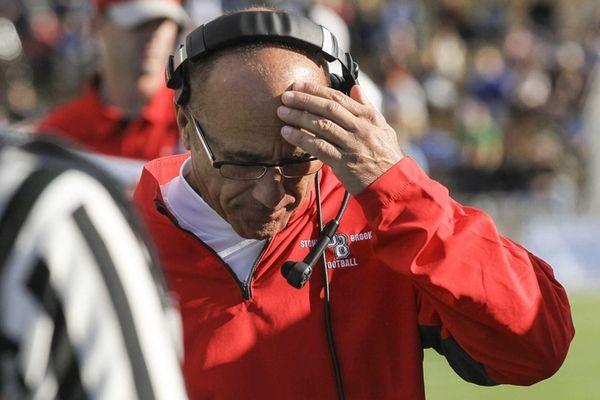 Stony Brook head coach Chuck Priore rubs his