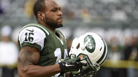 Jets wide receiver Percy Harvin looks on during