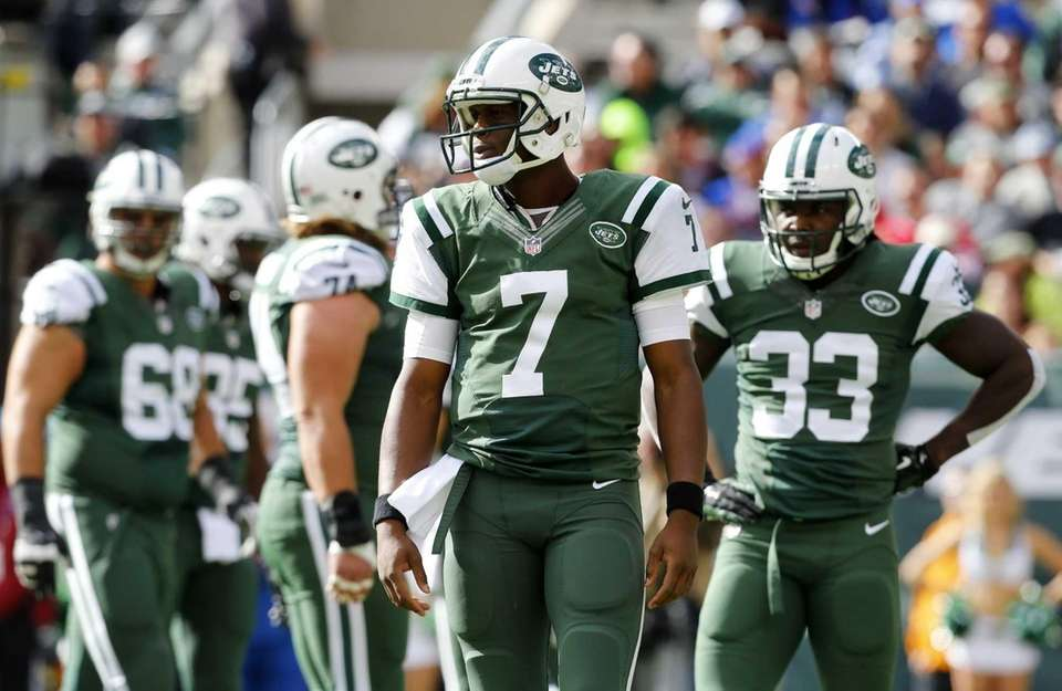 Geno Smith of the Jets looks on in