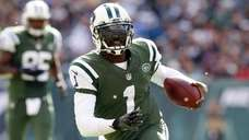 Michael Vick of the Jets runs the ball