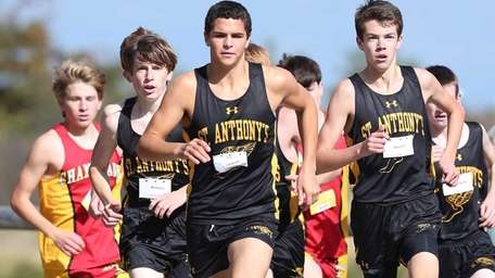The St. Anthony's cross country team heads toward