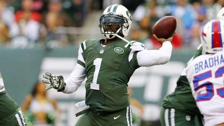 Michael Vick of the Jets throws a pass